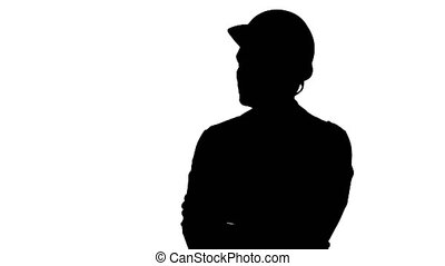 Silhouette Construction worker looking at his watch. Builder...