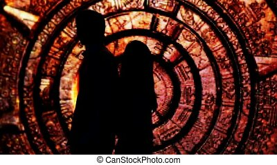silhouette young couple who had their backs to each other in fabulous decoration tunnel, then turn around and kiss