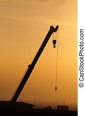 Silhouette crane working