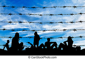 Silhouette crowd of refugees rest on ground - Concept of...