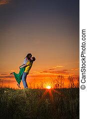 silhouette, di, agganciare tramonto