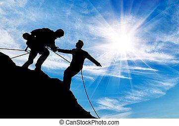silhouette, di, due, arrampicatori