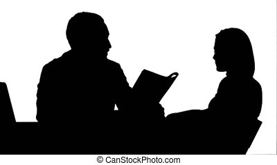 Silhouette Doctor and patient discussing - visit in the office track matte
