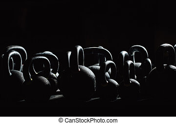 Silhouette Dumbbell for weight training in gym. Black kettlebells.