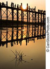 U Bein Bridge - Silhouette during sunset at U Bein Bridge,...