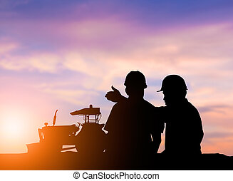 Silhouette engineer standing orders - silhouette two men to...