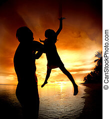 silhouette family of child hold on father hand