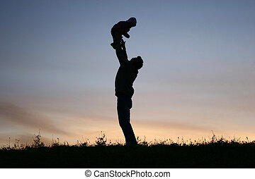 silhouette father with baby