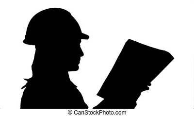 Silhouette Female construction engineer reading plans and talk to workers.