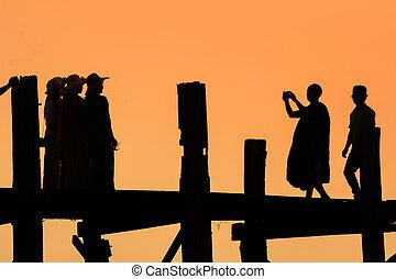 U Bein Bridge - Silhouette fo people walking at U Bein...