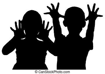Silhouette frightening children who raised their hands