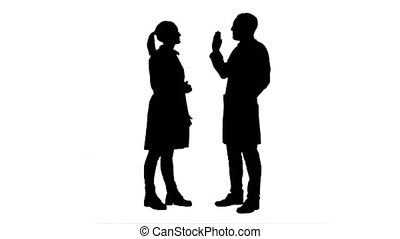 Silhouette Funny male doctor kidding on female nurse give a false hi five.