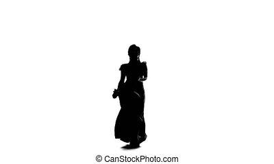 Silhouette Girl dances flamenco.