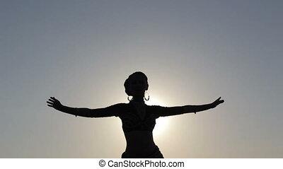 Silhouette girl dancing exotic dance