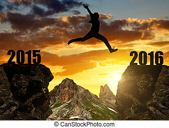 Girl jumps to the New Year 2016 - Silhouette Girl jumps to...