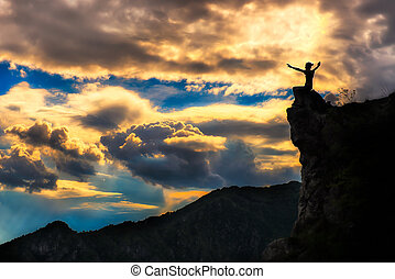 girl on a rock in the mountains