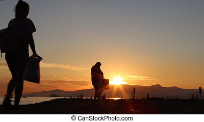 Silhouette girl walking sunset concept vacations