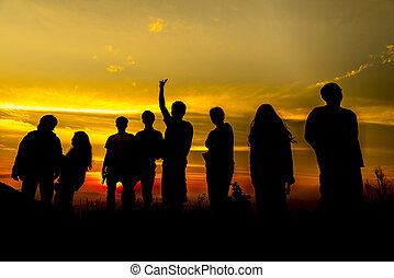 Silhouette group of people at sunset