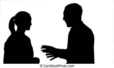 Silhouette Handsome man and attractive young woman talking and smiling.