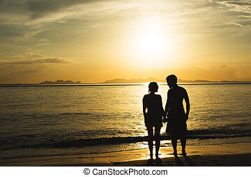 silhouette happiness and romantic scene of love couples partners on the beach.