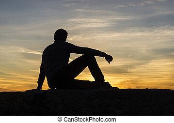 silhouette, hemel, seated, ondergaande zon , tegen, man