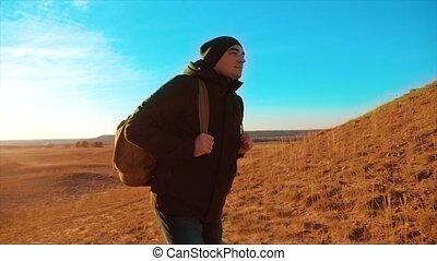 Silhouette hiker man of backpacker. steadicam motion...