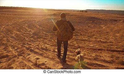 Silhouette hiker man of backpacker. steadicam motion video sunlight sunset person side view walking toward successful. lonely man lifestyle with sunset background. Travel and success concept the adventure