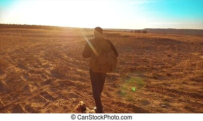 Silhouette hiker man of backpacker. steadicam motion video sunlight sunset person side view walking toward successful. lonely lifestyle man with sunset background. Travel and success concept the adventure