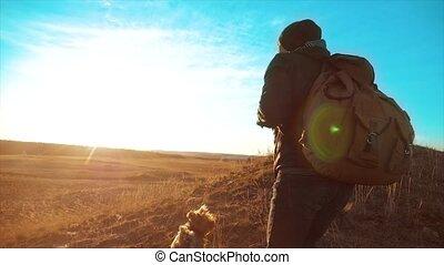 Silhouette hiker man of backpacker. steadicam motion video...