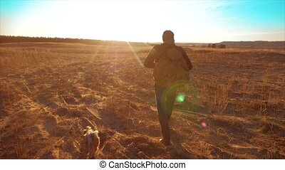 Silhouette hiker man of backpacker. steadicam motion video sunlight sunset person side view walking toward successful. lifestyle lonely man with sunset background. Travel and success concept the adventure