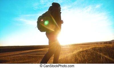 Silhouette hiker man of backpacker sunlight. steadicam...