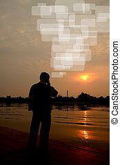 Silhouette image of business man made a phone call