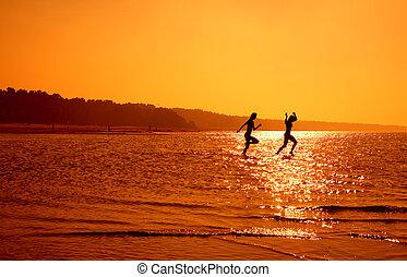 running girls - silhouette image of two running girls in ...
