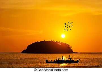 Silhouette island with fishing boat and bird in color of the sunset
