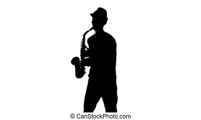 Silhouette jazzman performs solo on saxophone. White background in studio