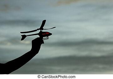 silhouette, jouet, hélicoptère, main