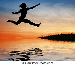 silhouette jump girl on water
