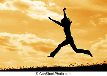 silhouette jump - silhouette of jumping woman on the sky...