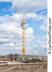 Silhouette Lift crane on construction site with blue sky and white cloud