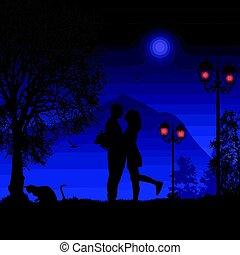Silhouette loving couple on beautiful blue night