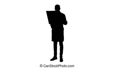Silhouette Male doctor analysing Xray results