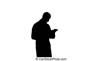 Silhouette Male doctor using digital tablet