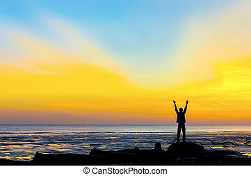 silhouette man against sunset