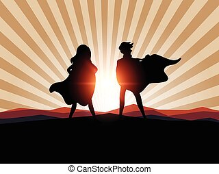 Silhouette man and women superhero with sunlight.