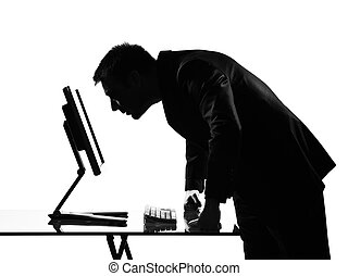 silhouette man computing
