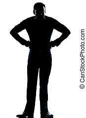 silhouette man full length angry hands on hips