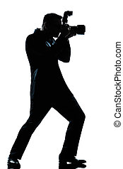 one caucasian man photographer full length silhouette in studio isolated white background