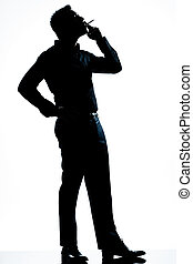 silhouette man full length smoking cigarette