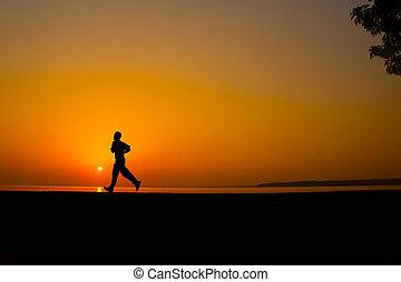 Silhouette man jogging