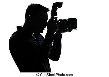 silhouette man portrait photographer - one caucasian man...